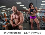 a young muscular guy is sitting ... | Shutterstock . vector #1374799439