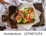 sandwich with prosciutto  jamon ... | Shutterstock . vector #1374871253