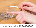 smoking  hand and cigarette | Shutterstock . vector #1374884840