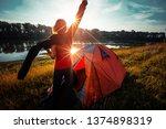 young woman hiker stands near... | Shutterstock . vector #1374898319