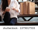 young woman holding sale... | Shutterstock . vector #1375017533