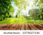 wooden table and spring forest... | Shutterstock . vector #1375027130