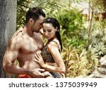 young couple taking shower... | Shutterstock . vector #1375039949