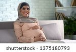 Happy Pregnant Woman In Hijab...