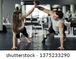 happy sporty couple giving high ... | Shutterstock . vector #1375233290
