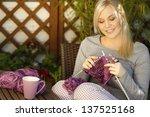 woman knitting on terrace | Shutterstock . vector #137525168