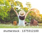 happy woman with arms... | Shutterstock . vector #1375312100