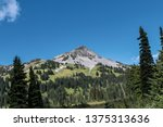 looking up at a mountain peak... | Shutterstock . vector #1375313636