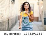 young african woman with... | Shutterstock . vector #1375391153