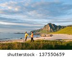 couple walking around beach in... | Shutterstock . vector #137550659