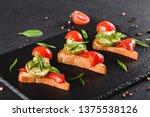 appetizer bruschetta with... | Shutterstock . vector #1375538126