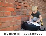 little pupil doing homework on... | Shutterstock . vector #1375559396