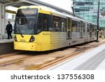 Постер, плакат: People board Manchester tram