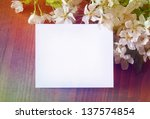 paper card in cherry blossom | Shutterstock . vector #137574854