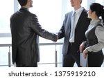 smiling business team looking... | Shutterstock . vector #1375919210