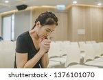 woman praying in the church.... | Shutterstock . vector #1376101070