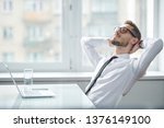 happy young restful office... | Shutterstock . vector #1376149100