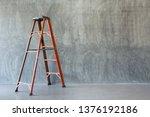 Orange Iron Ladder  On Bare...