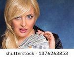 beautiful blonde holds money in ...   Shutterstock . vector #1376263853