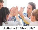 coworkers doing high five...   Shutterstock . vector #1376318099