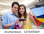 smiling couple looking at... | Shutterstock . vector #137645069