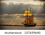 A Three Master Sailing On The...