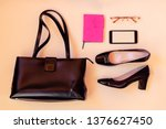 black leather bag  black shoes  ... | Shutterstock . vector #1376627450