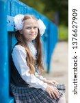 schoolgirl in school uniform... | Shutterstock . vector #1376627909