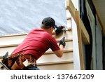 Young Homeowner Installs Sidin...