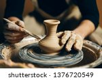 Man Potter Working On Potters...