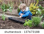 Adorable Blond Boy  Planting...