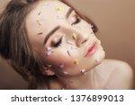 flower petals on face girl ... | Shutterstock . vector #1376899013