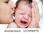Mom Soothes A Crying Baby
