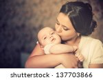 young mother kissing her little ... | Shutterstock . vector #137703866
