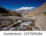 mountain stony river against a... | Shutterstock . vector #1377049286