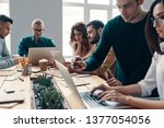 cooperation in action. group of ... | Shutterstock . vector #1377054056