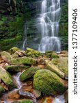 Small photo of middle black clough waterfall with wet stones and moss
