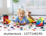 kids play with toy cars in... | Shutterstock . vector #1377148190