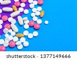 a pile of multicolored pills on ... | Shutterstock . vector #1377149666