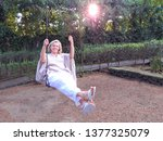 Smiling Mature Woman Sitting O...