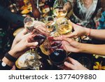 champagne glasses in hands of... | Shutterstock . vector #1377409880