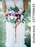 bride in white dress holding... | Shutterstock . vector #1377458633