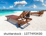 wooden sunbed on tropical beach ... | Shutterstock . vector #1377493430