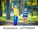 happy two brother kids playing... | Shutterstock . vector #1377494600