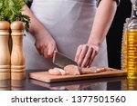 young woman in a gray apron... | Shutterstock . vector #1377501560