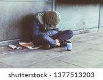 Homeless Adult Man Sitting On...