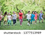 a group of happy children of... | Shutterstock . vector #1377513989