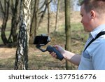 a young man videotaping on a...   Shutterstock . vector #1377516776
