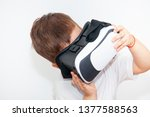little boy with virtual reality ... | Shutterstock . vector #1377588563