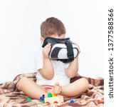 little boy with virtual reality ... | Shutterstock . vector #1377588566